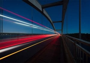speeding lights across bridge