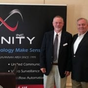 Chuck Brown and Bill Hubbard smile as Infinity sponsors Chamber New Member Orientation