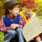 Savannah book challenge with two boys smiling and reading