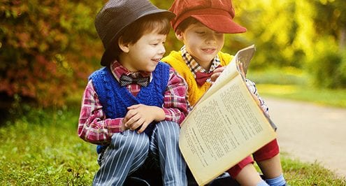 million book challenge - two boys smiling reading