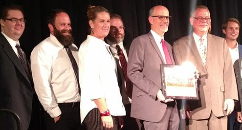 Infinity Inc. staff receives the Chamber Small Business of the Year award