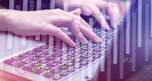 digital transformation blog showing hands typing on a laptop with digital overlay
