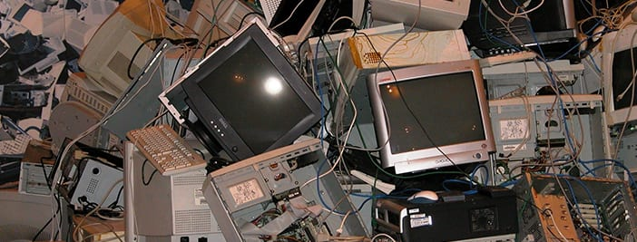 stack of old business electronic devices like computers