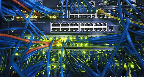 tangle of cables and ports for in-house network