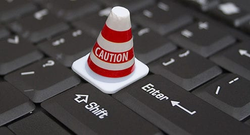 warning cone on keyboard to show caution and liability
