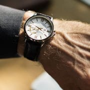 hand with wristwatch and suit