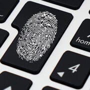 Fingerprint on keyboard for password manager benefits