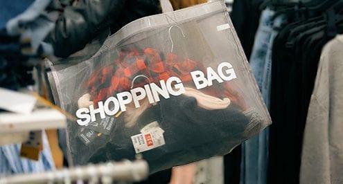 shopper in a store helped by seasonal staff