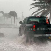 Truck driving through flooded road to show importance of disaster recovery planning