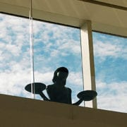 Bird Girl statue in front of window at Telfair Museums Jepson Center