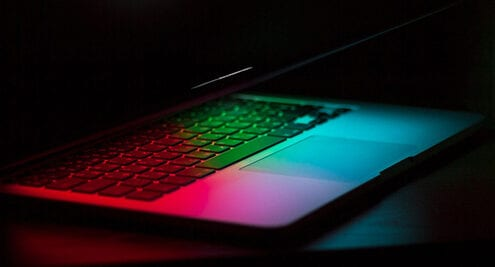 laptop glowing in the dark with hidden microsoft tools