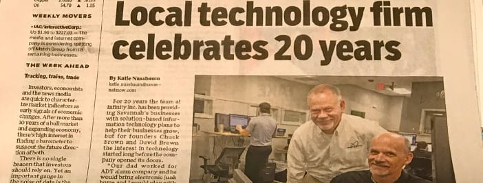 newspaper shows Chuck and David brown of Infinity, Inc. a Savannah IT firm