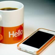coffee cup and phone saying hello to new team members