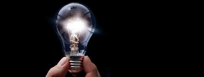 glowing lightbulb in dark for changing logo rebranding ideas