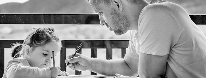 father drawing with daughter to show work life balance with voip