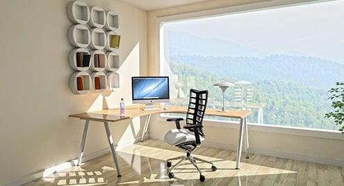 sunlight shining in home office with happy employee working remotely