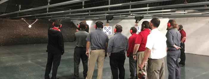 Infinity employees at target shooting range