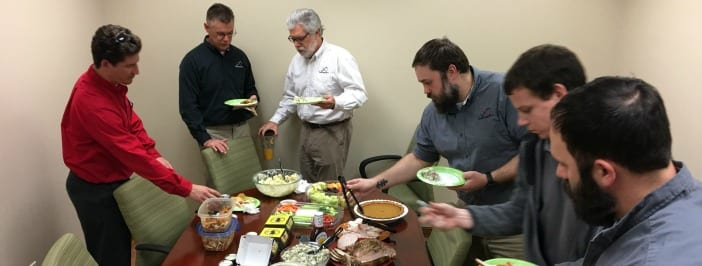 Infinity employees at office potluck