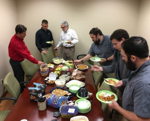 Infinity employees enjoying office potluck